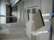 Powder coating on shelves and furniture of stores with clear coat